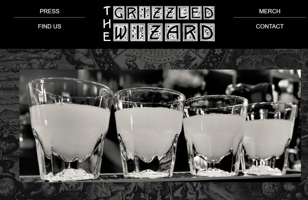 <b>The Grizzled Wizard</b></br> Voted Seattle's best dive bar!